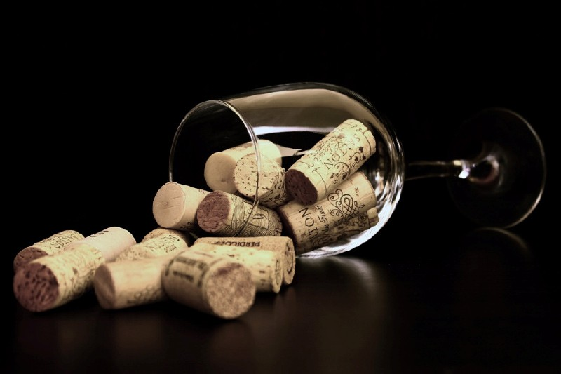 spilled corks from toppled glass
