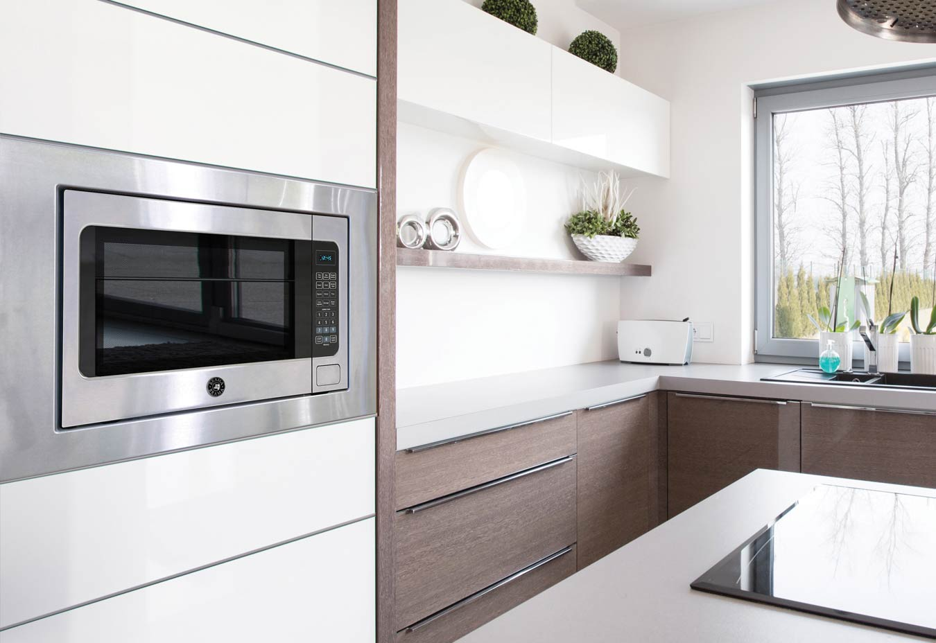 microwave oven installed into cabinet