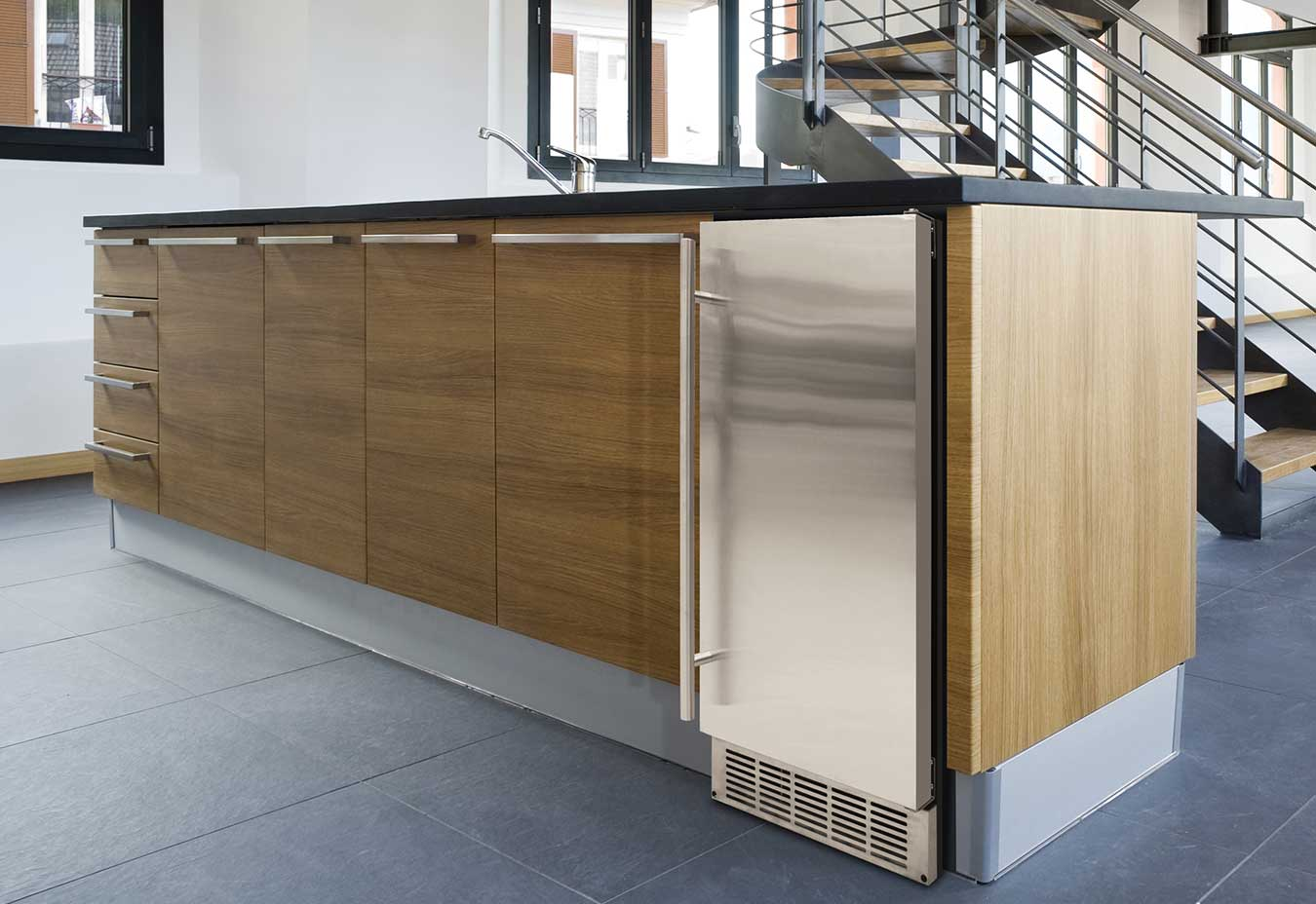 stainless ice maker in wood cabinetry