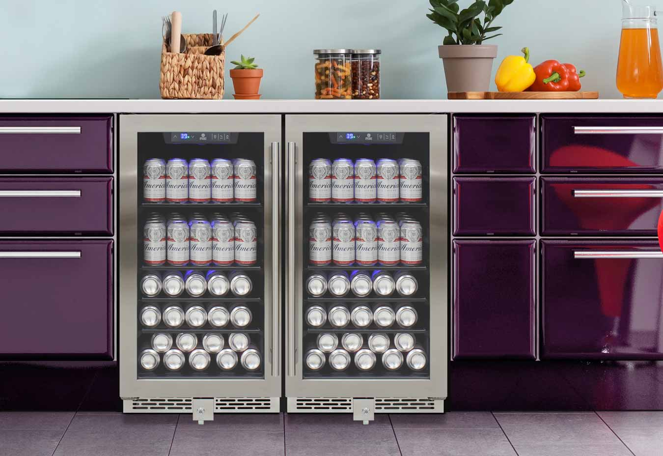 stainless trim beverage coolers installed next to each other into purple cabinets